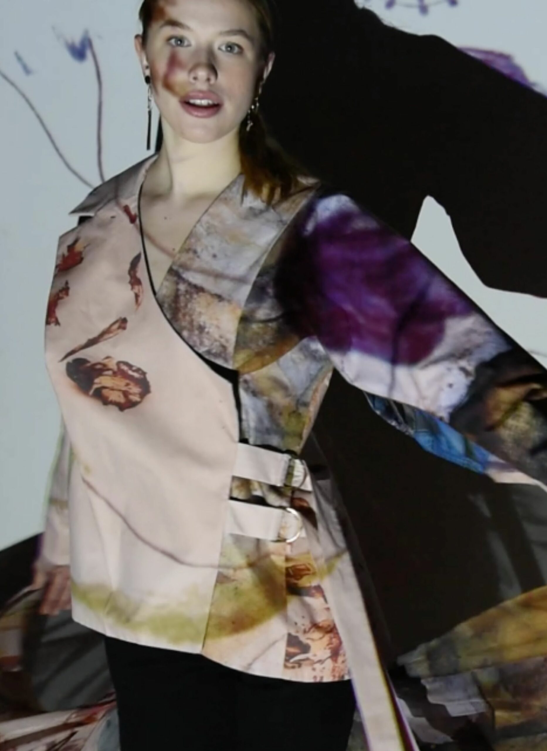 Model wearing layered top with photos printed on it