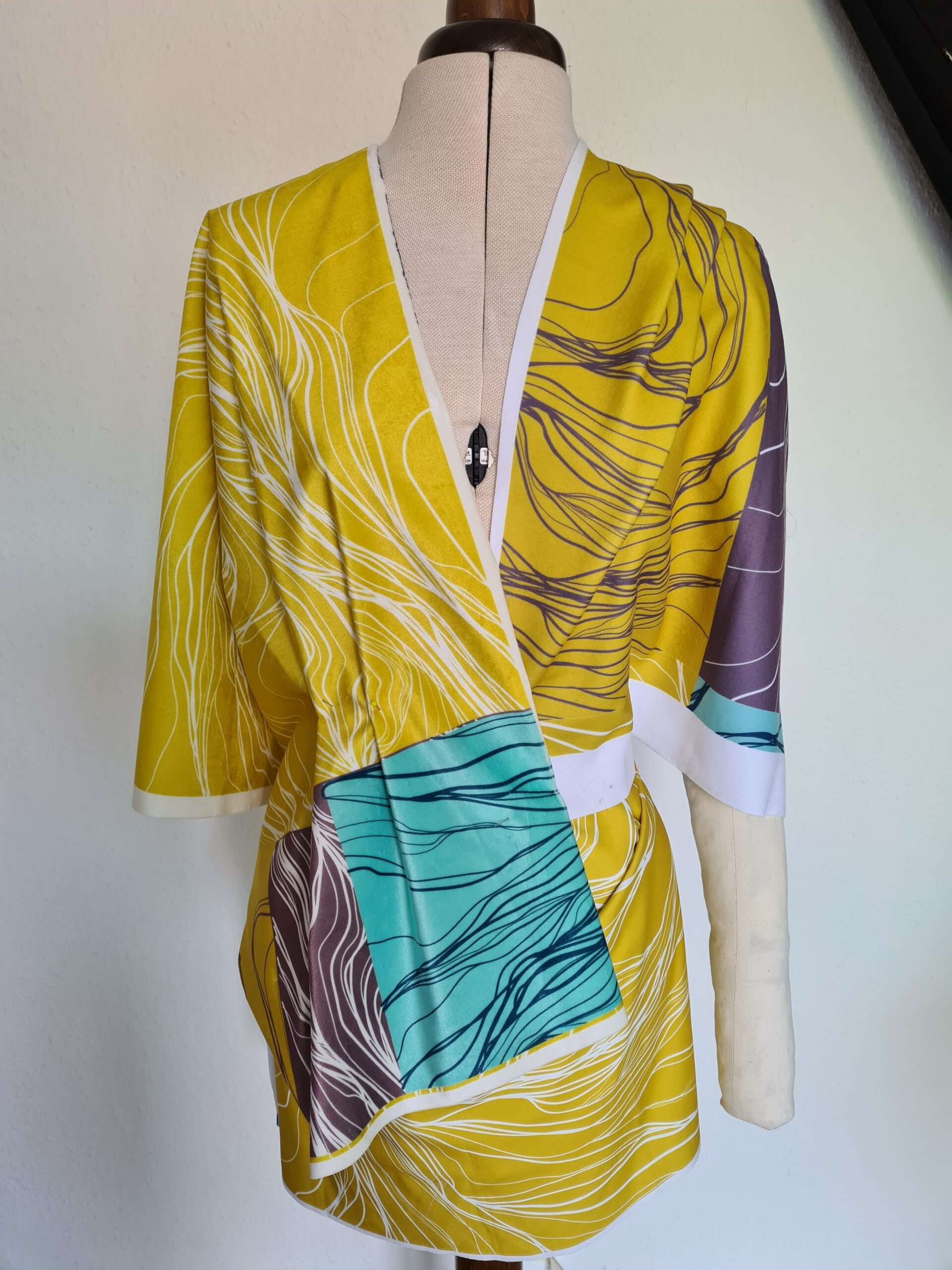 Draped fabric over a dress form