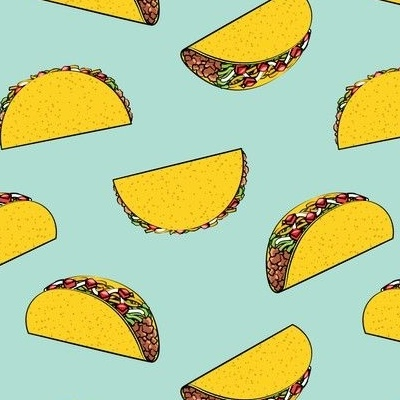 Tacos float on a mint background
