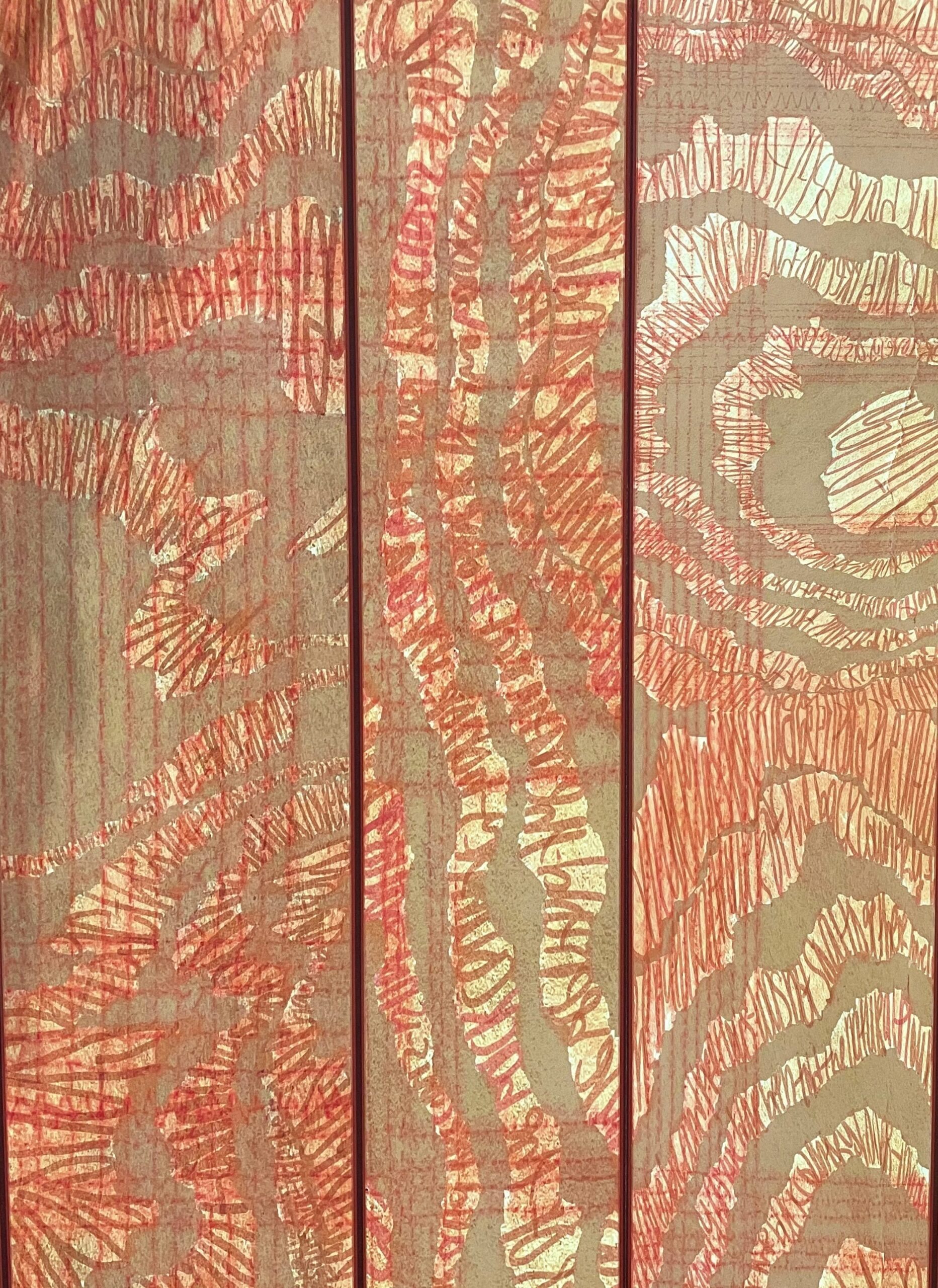 Close up of wallpaper with wood grain and writing details