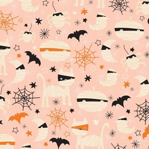 Fabric design with pink background and white pumpkins and cats
