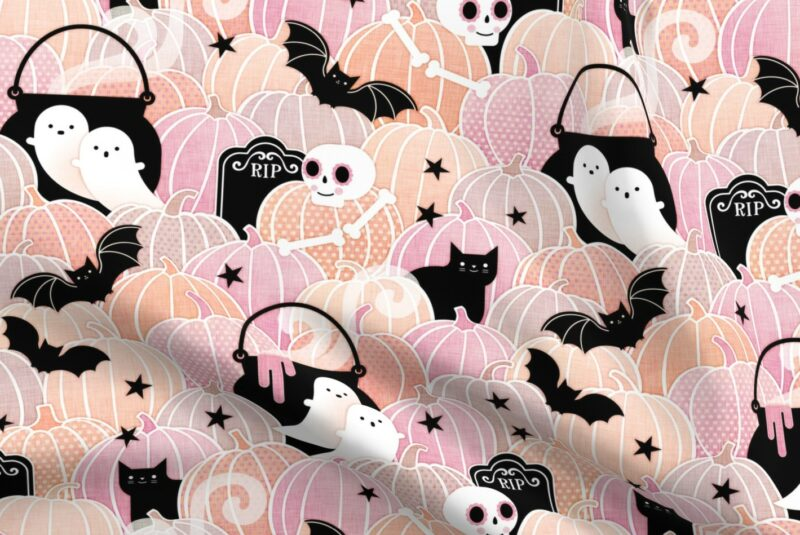 Fabric design with pastel pink and orange pumpkins with ghosts, cats, bats and skeletons