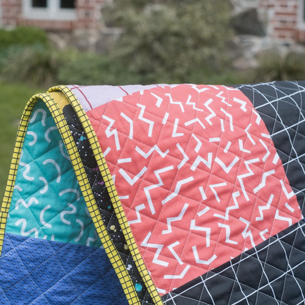 Quilt using ditsy surface designs inspired by the 80s