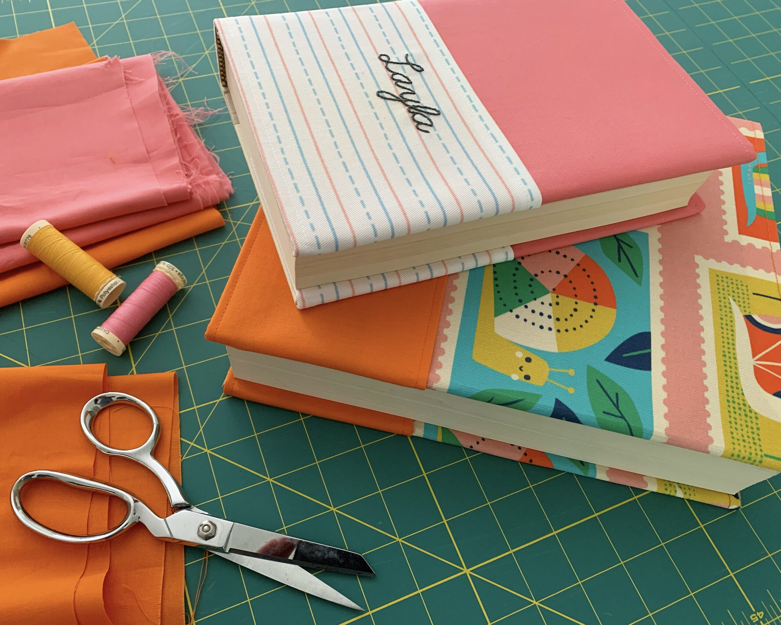Books with brightly colored handmade book covers