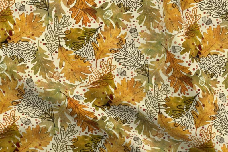 Fabric design with brown and yellow toned leaves and acorns