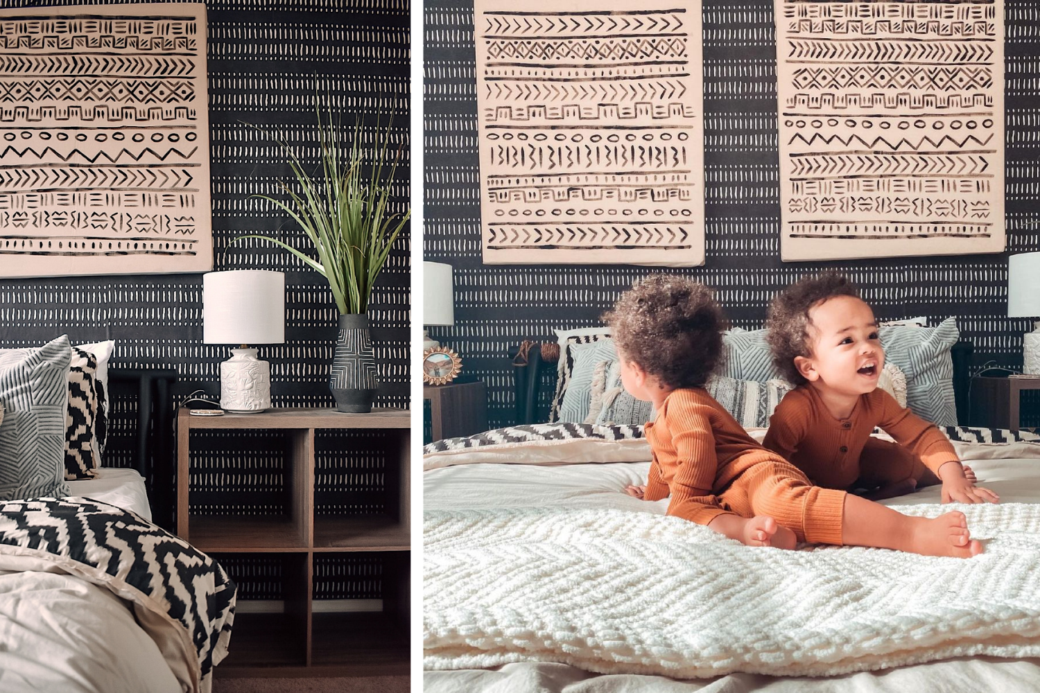 Two toddlers on a bed in a room with an expressive wallpaper pattern