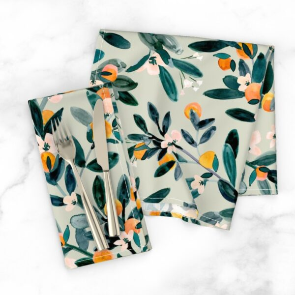 Dinner napkins with floral design on a dining table