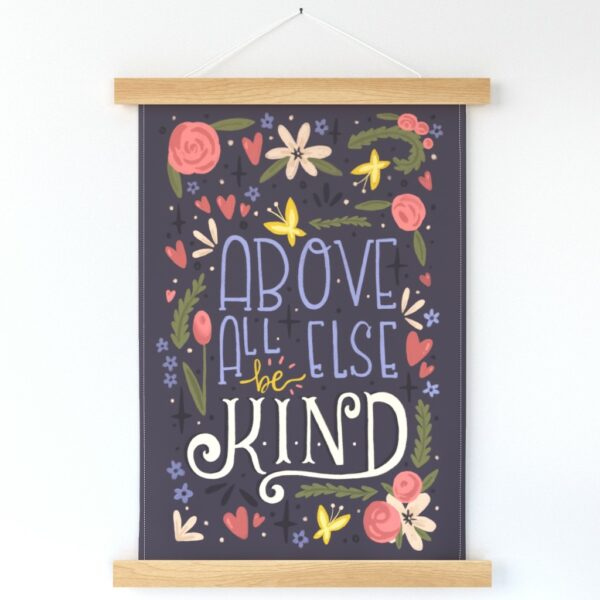 """Wall Hanging with floral illustrator and hand lettering that says """"Above All Else, Be Kind"""""""