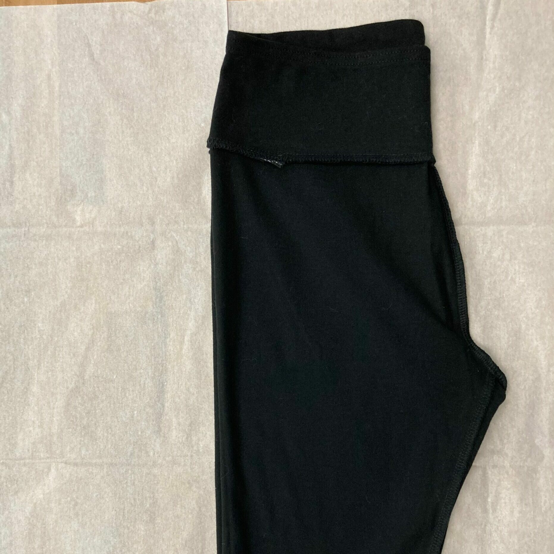 Leggings front laying on top of pattern paper