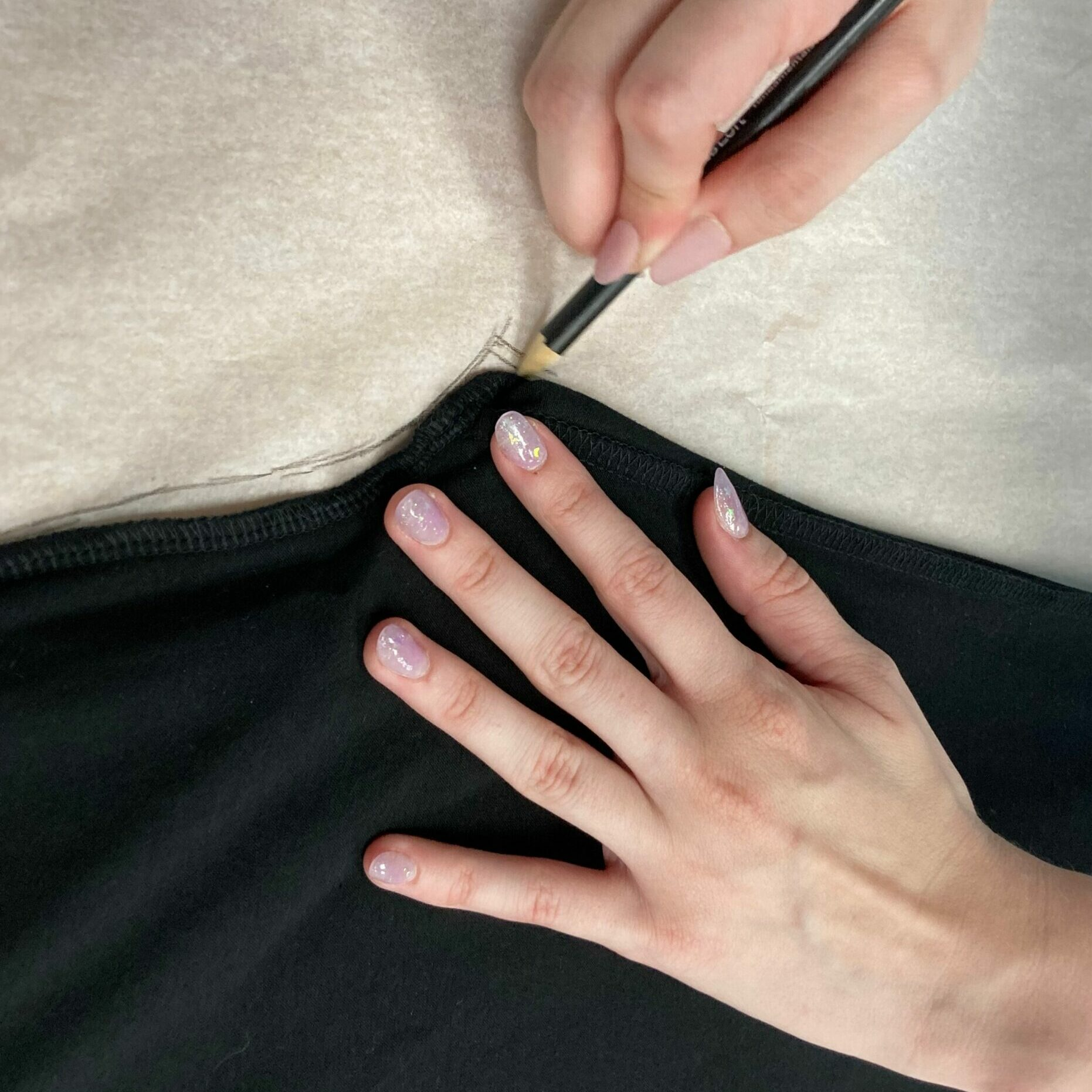 Tracing the leggings onto the pattern paper