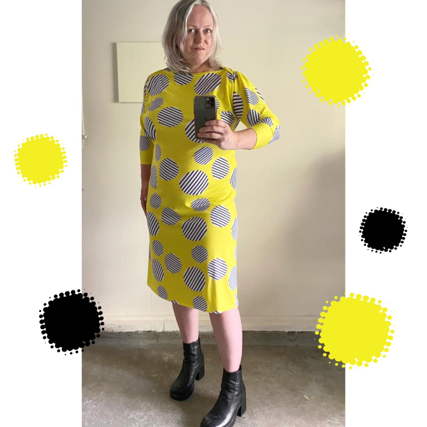 Ann Sullivan-Treacy wears a bright yellow dress with striped black and white circles