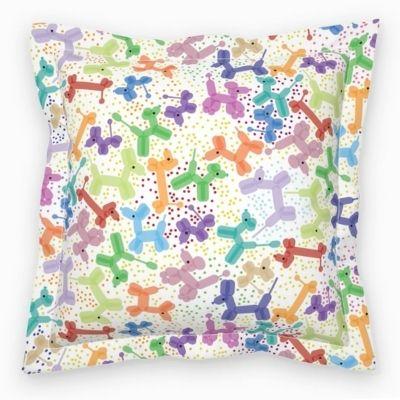 Square throw pillow with balloon animal design
