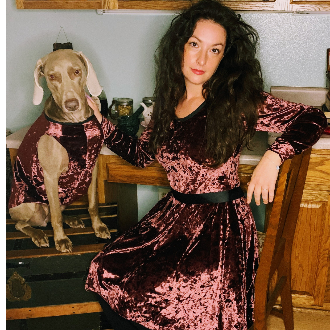 Fox and one of their rescue dogs wearing Fox's designs in burgundy velvet