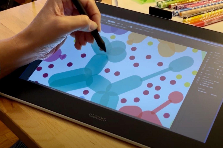 Samarra drawing balloon animals on her tablet