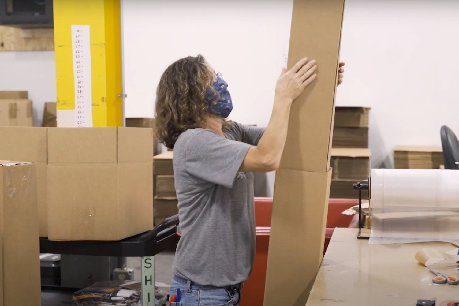 Person holding a wallpaper shipping box