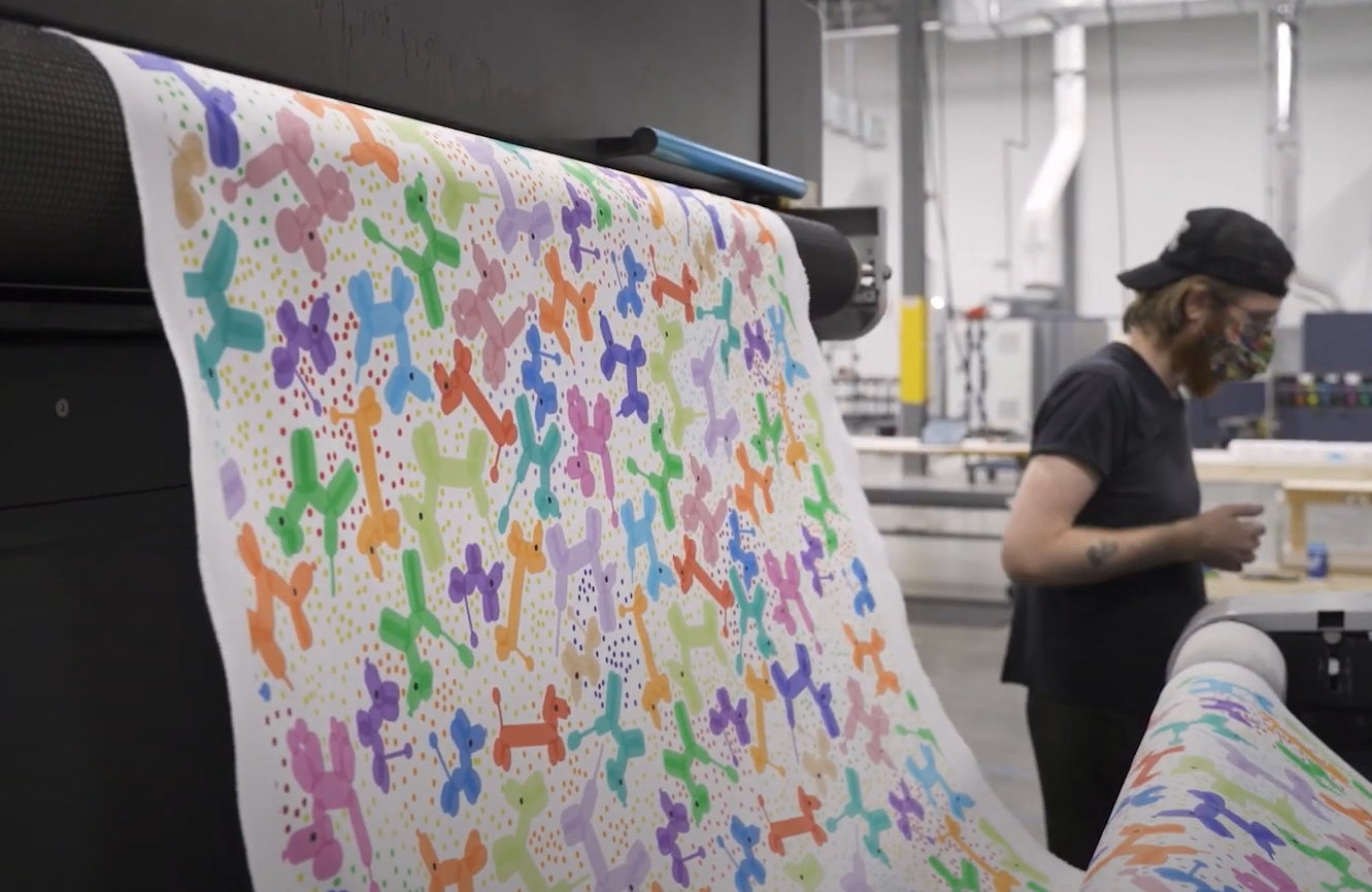 Balloon animal fabric rolling out from machine